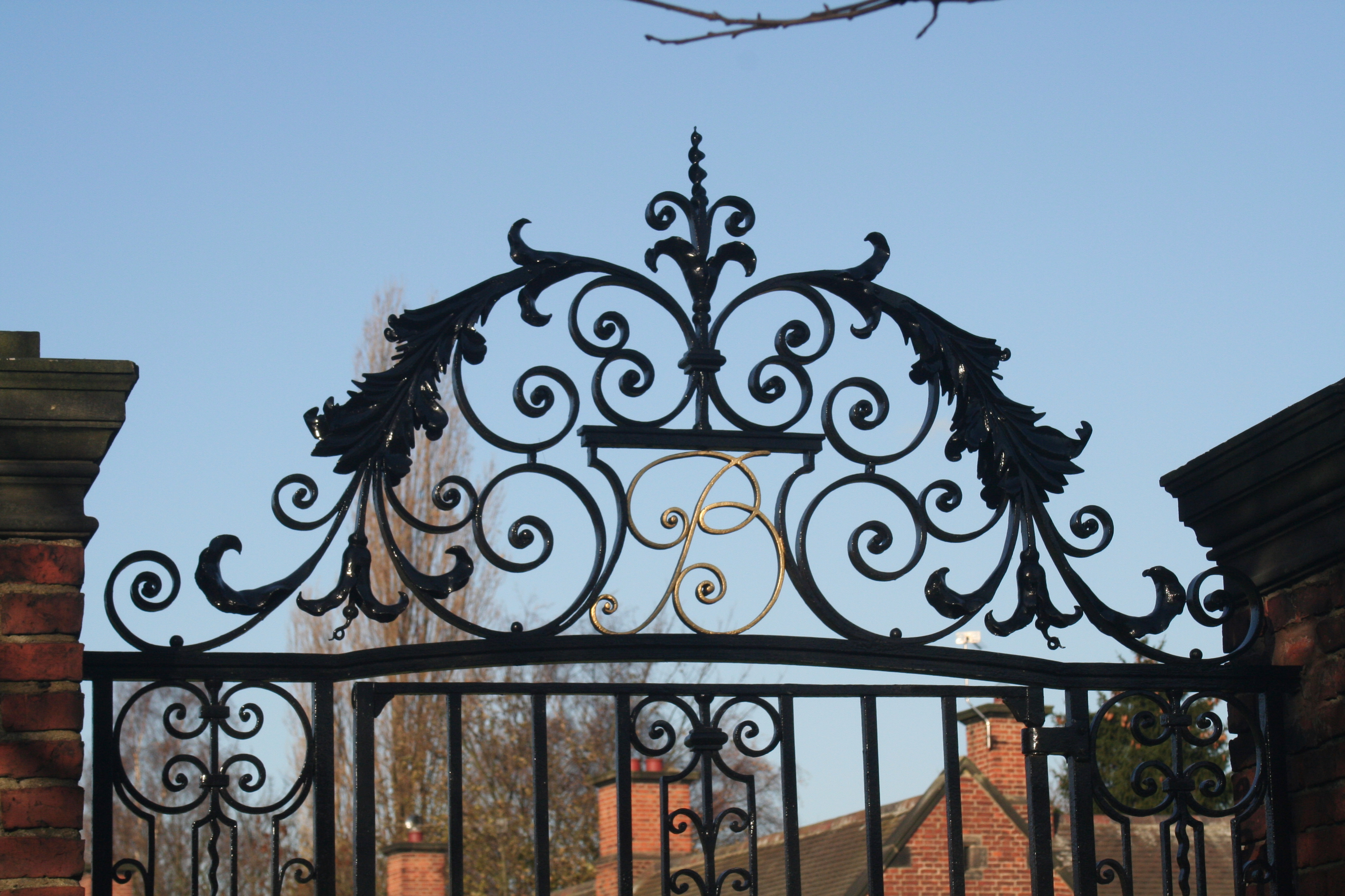 Wrought iron overthrow after full restoration